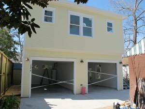 This side of the garage faces the street.  The bottom garage is divided into two separate sections.  Each has its own side door entrance.  The left side of the garage will be used as the workshop and the right side will be a gallery, classroom and social room as needed.